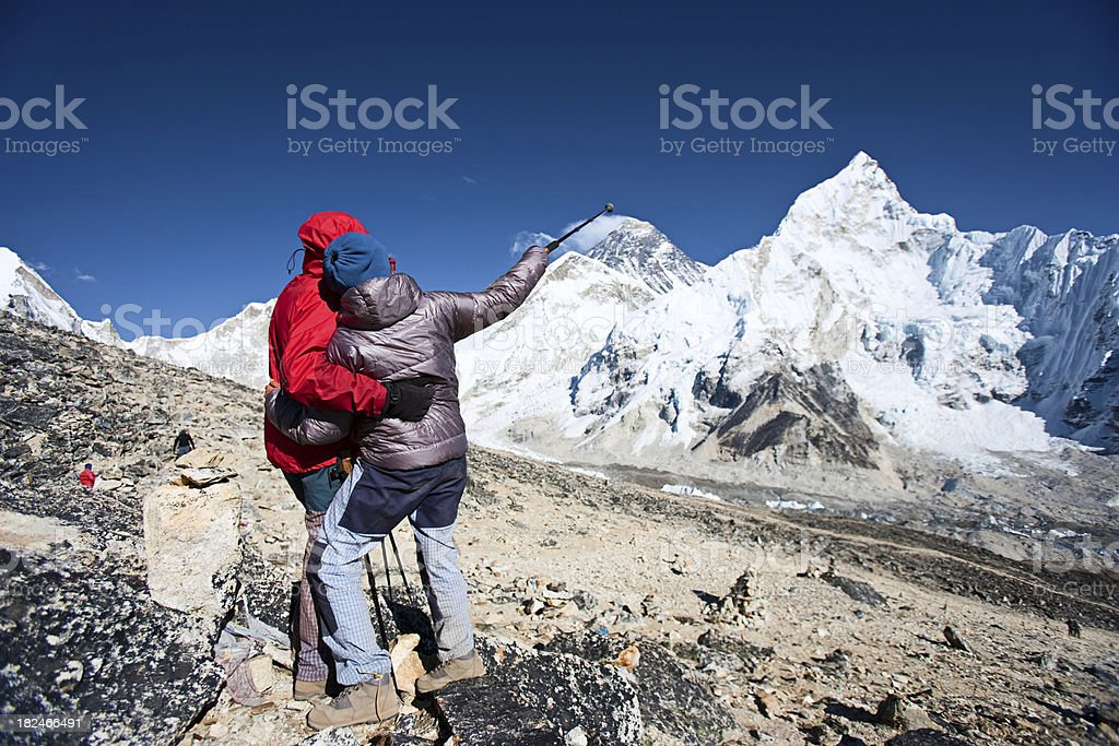 Couple looking at Mount Everest royalty-free stock photo