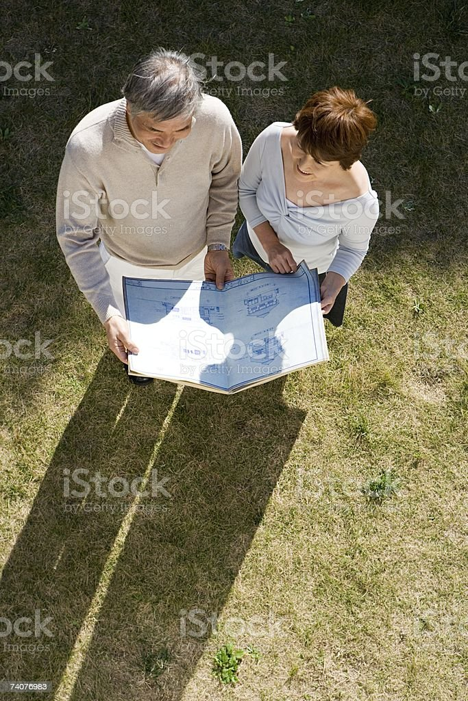 Couple looking at plans royalty-free stock photo