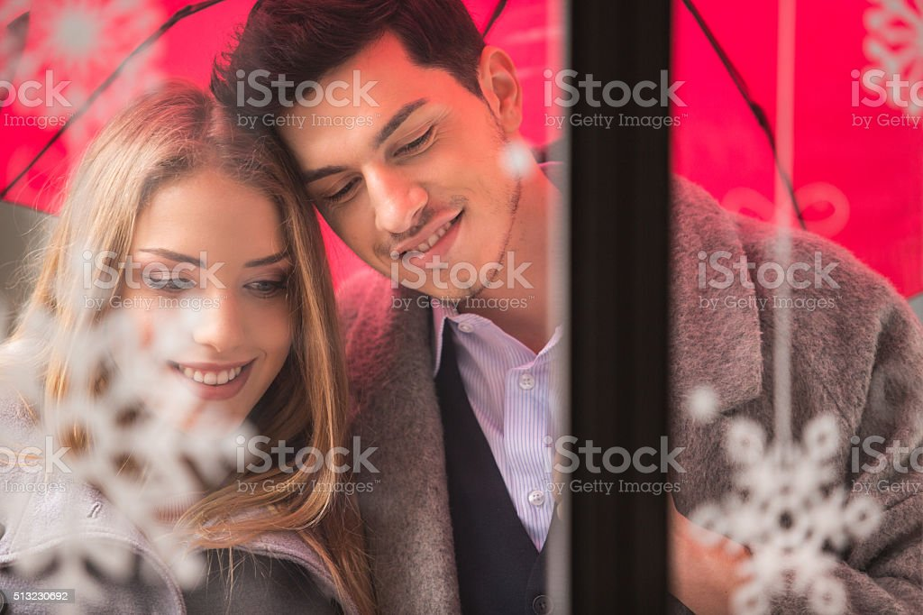 Couple looking at shop window stock photo