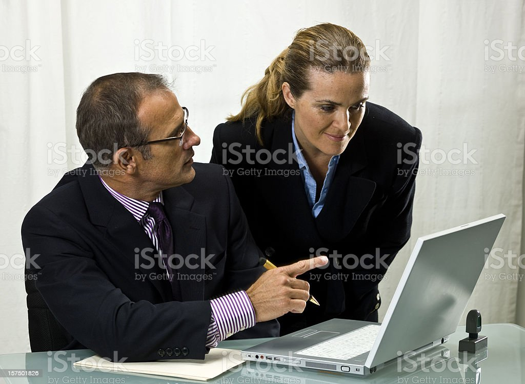 Couple looking at their laptop screen royalty-free stock photo