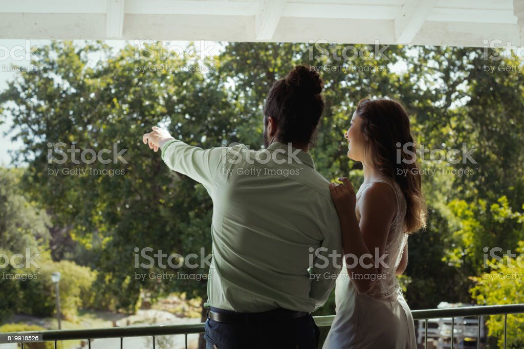 Rear view of couple looking at view in restaurant