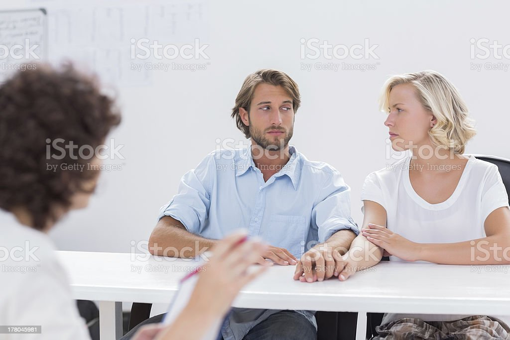 Couple looking doubtful during therapy session royalty-free stock photo