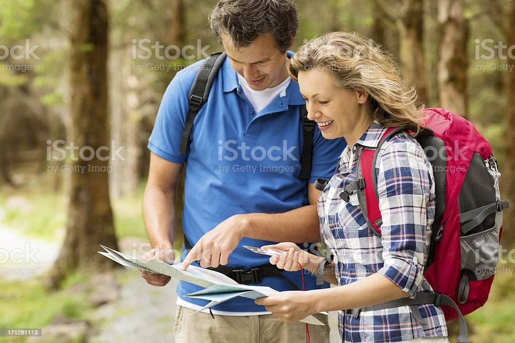 Couple Looking For Directions On the Map royalty-free stock photo