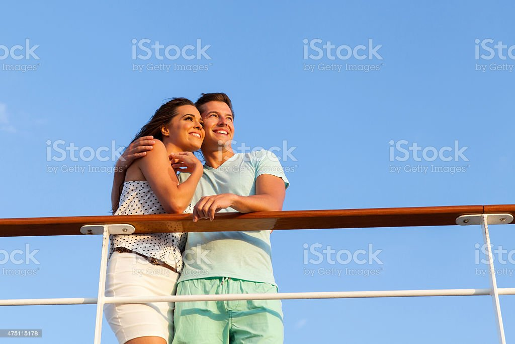 couple looking into the distance on cruise stock photo