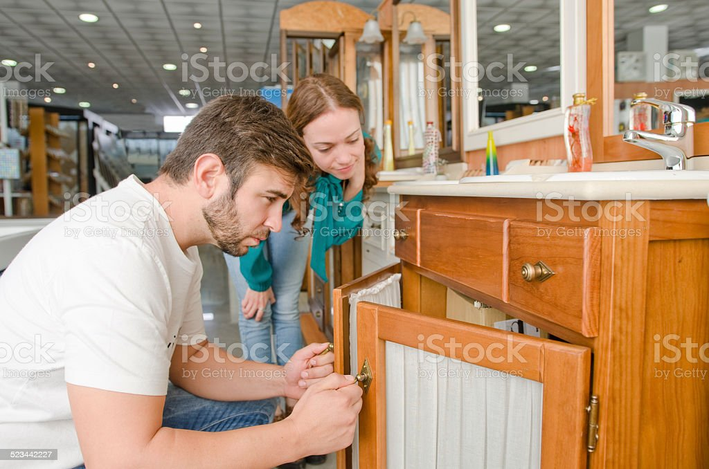 Couple looking sink in furniture shop stock photo