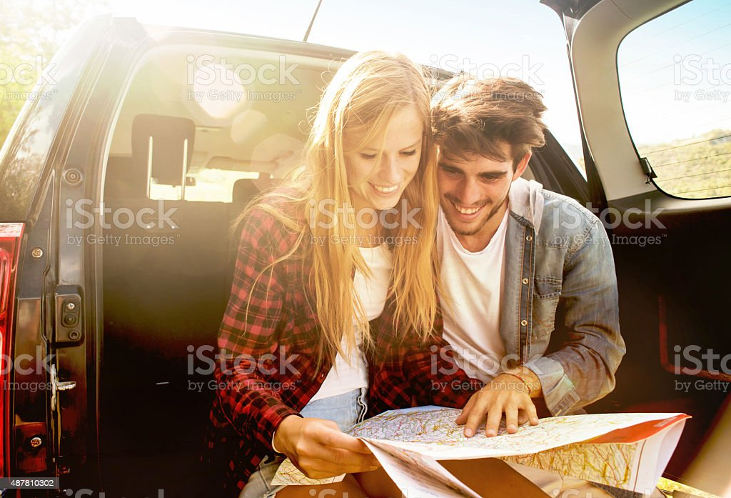 Couple looking the Itnerary on a Map stock photo