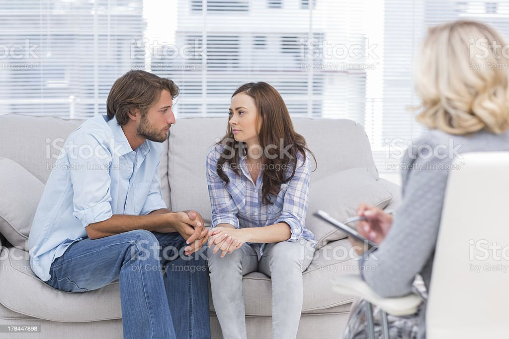 Couple looking to each other during therapy session royalty-free stock photo