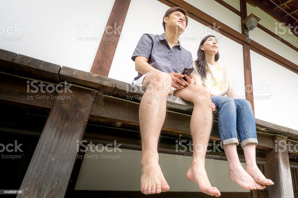 Couple looking up at Japanese House(Engawa) stock photo