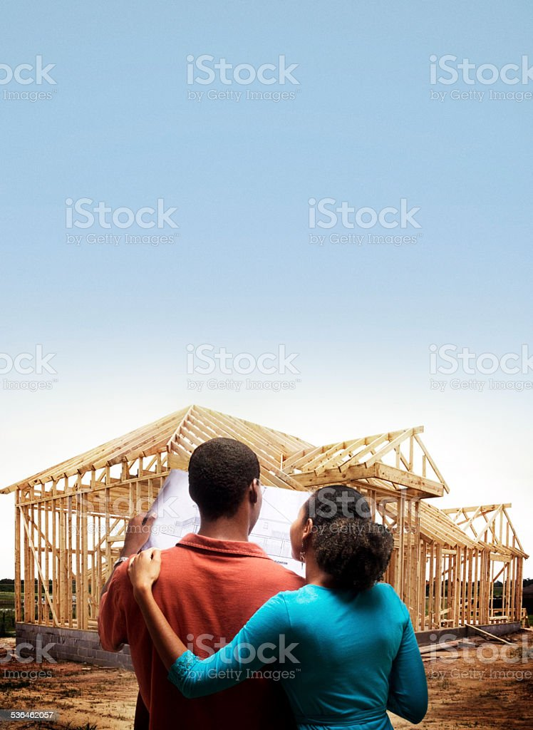 Couple lookint at Home stock photo