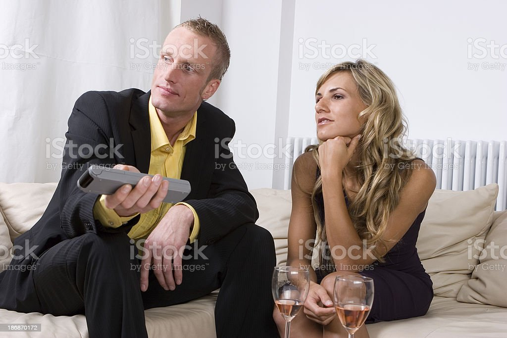 Couple looks TV together. royalty-free stock photo