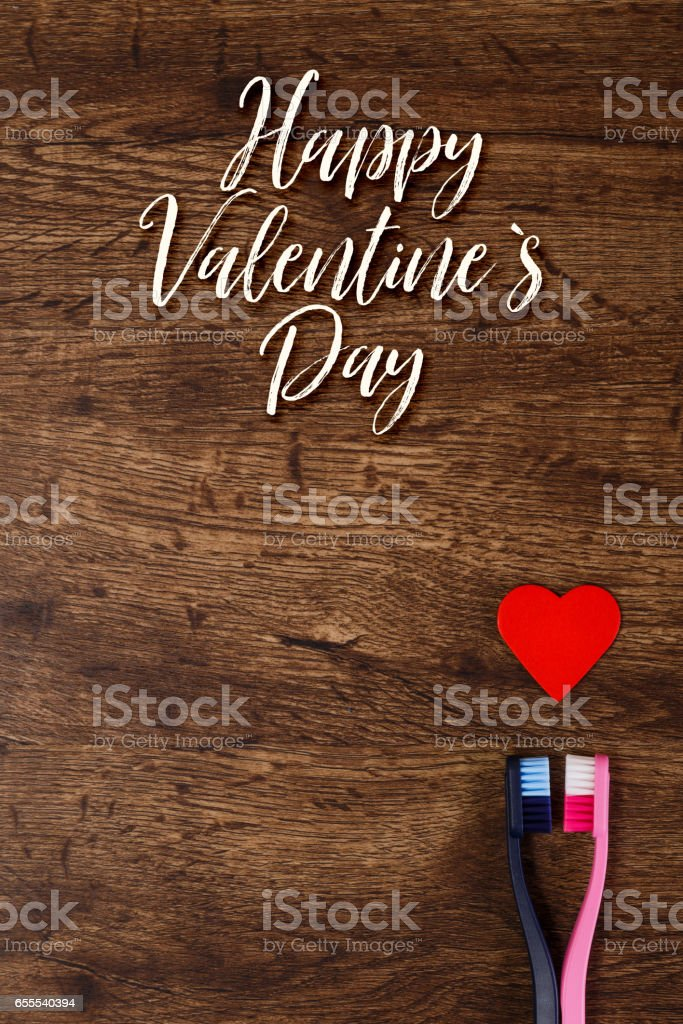 Couple love concept with heart and toothbrushes. stock photo