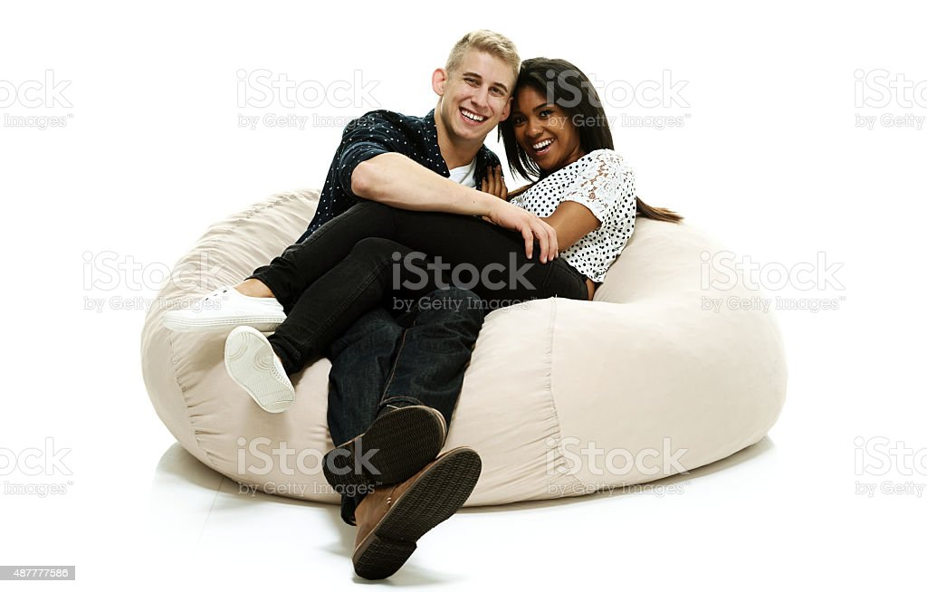 Couple lying down bean bag stock photo
