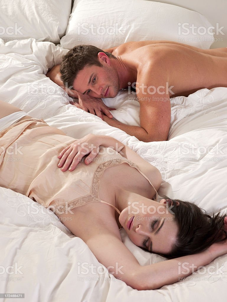 Couple lying in bed together royalty-free stock photo