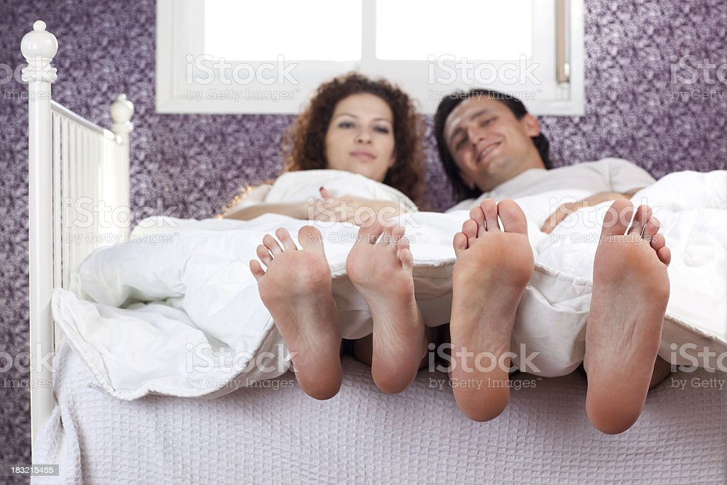 Couple lying in the bed bright morning. royalty-free stock photo