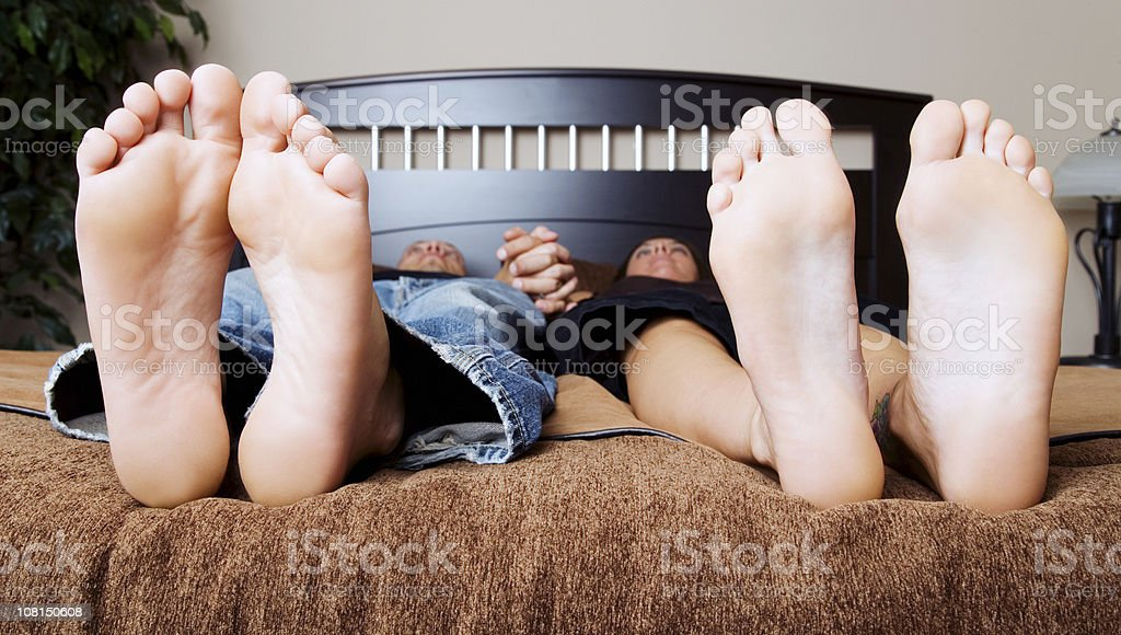 Couple Lying on Bed stock photo