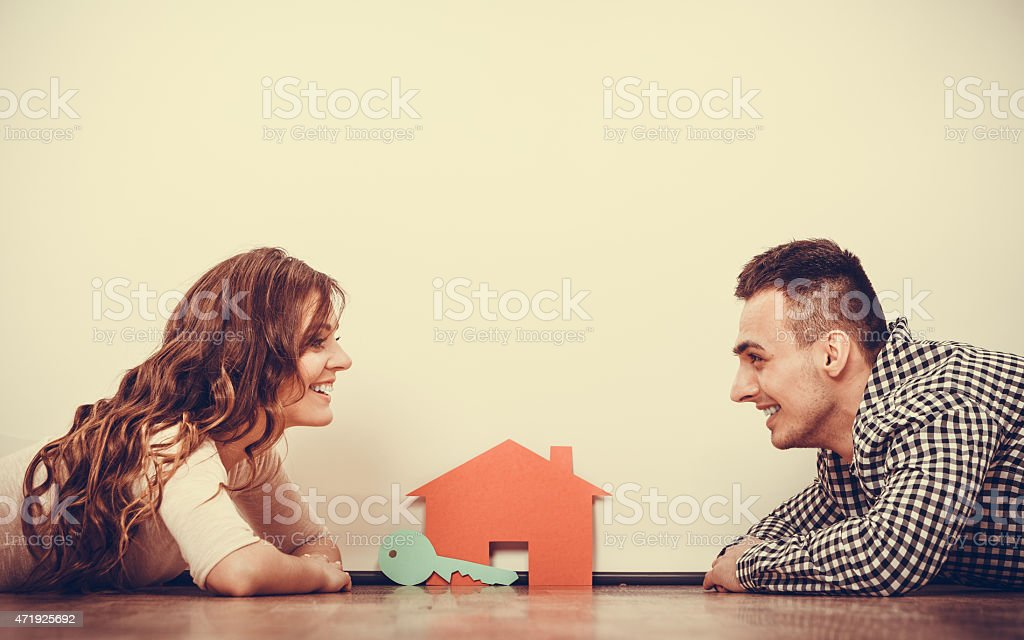 Couple lying on floor daydreaming at home stock photo