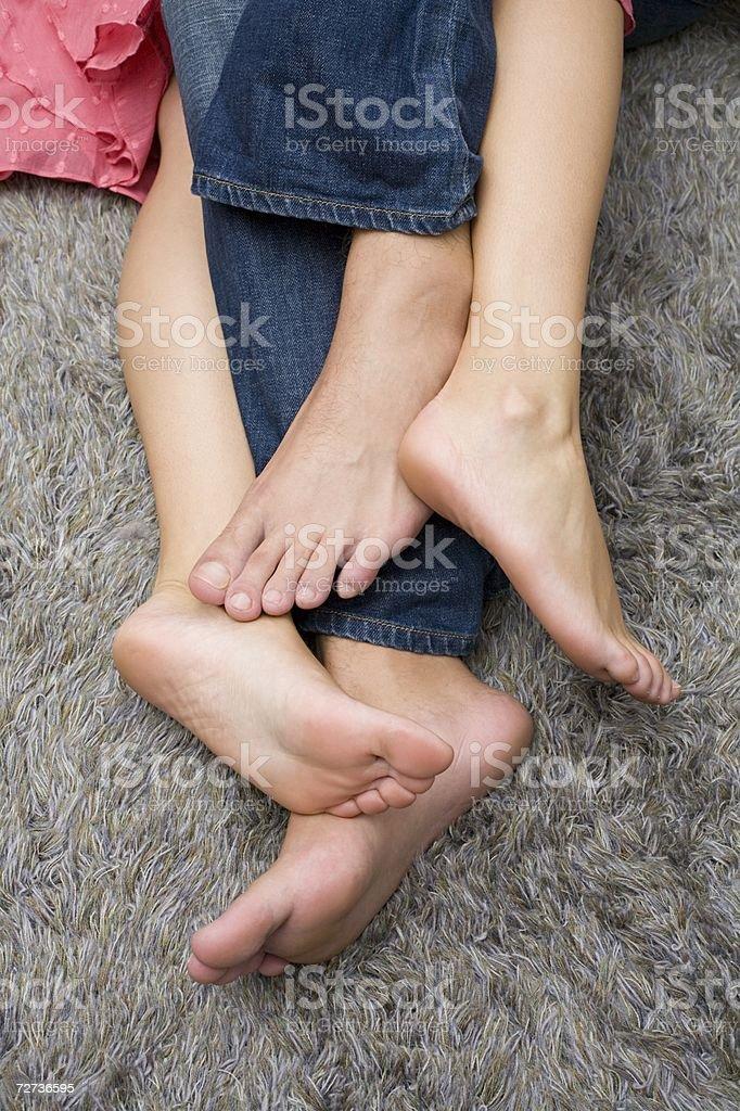 Couple lying on floor stock photo