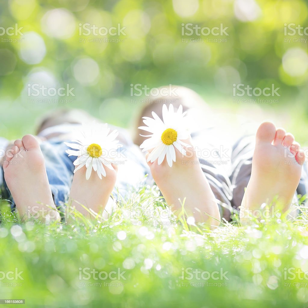 Couple lying on grass stock photo