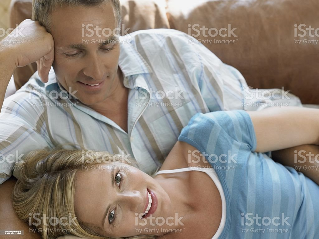 Couple lying on sofa royalty-free stock photo