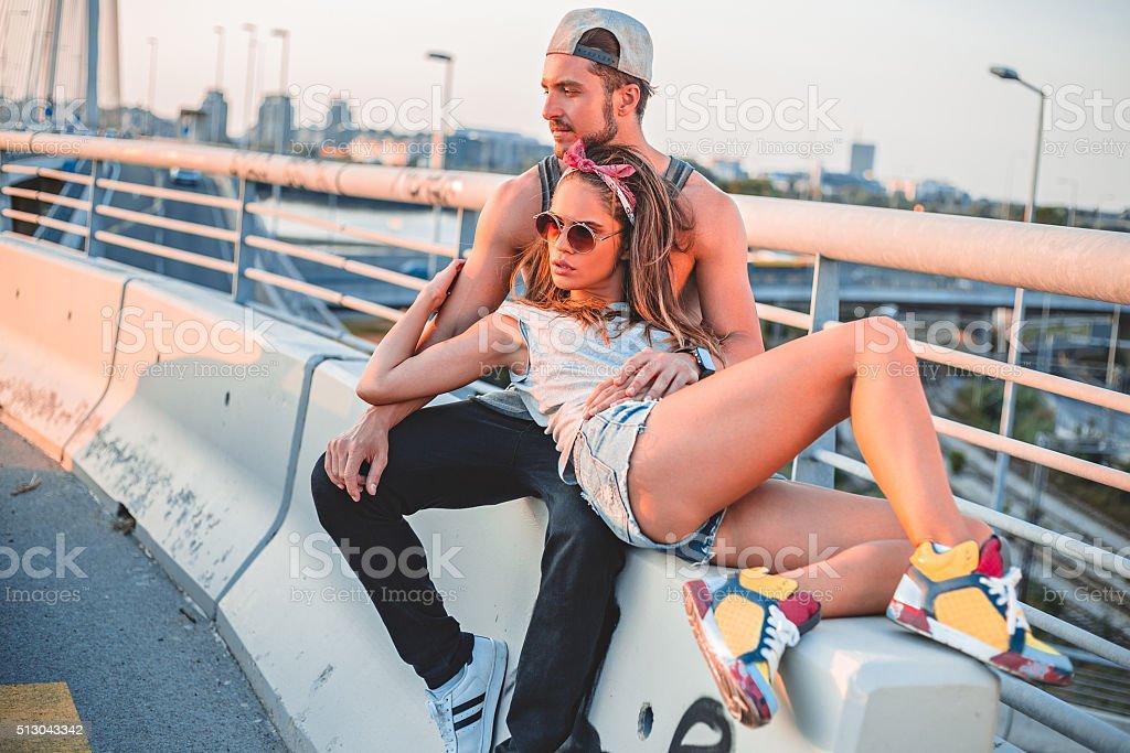 Couple lying on the bridge stock photo