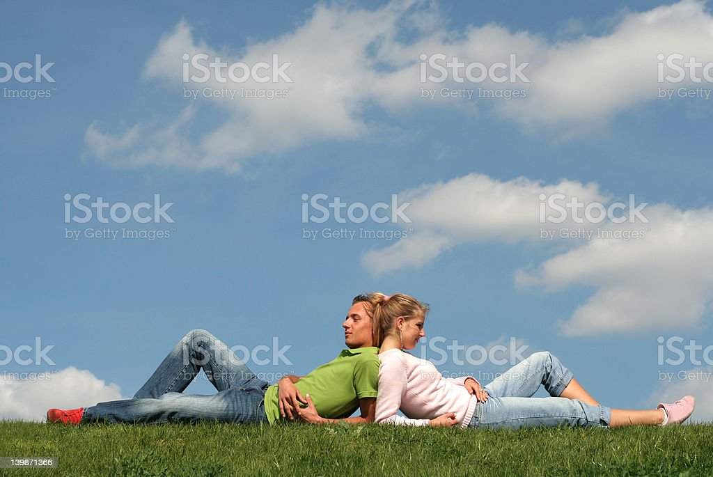 Couple lying on the grass royalty-free stock photo