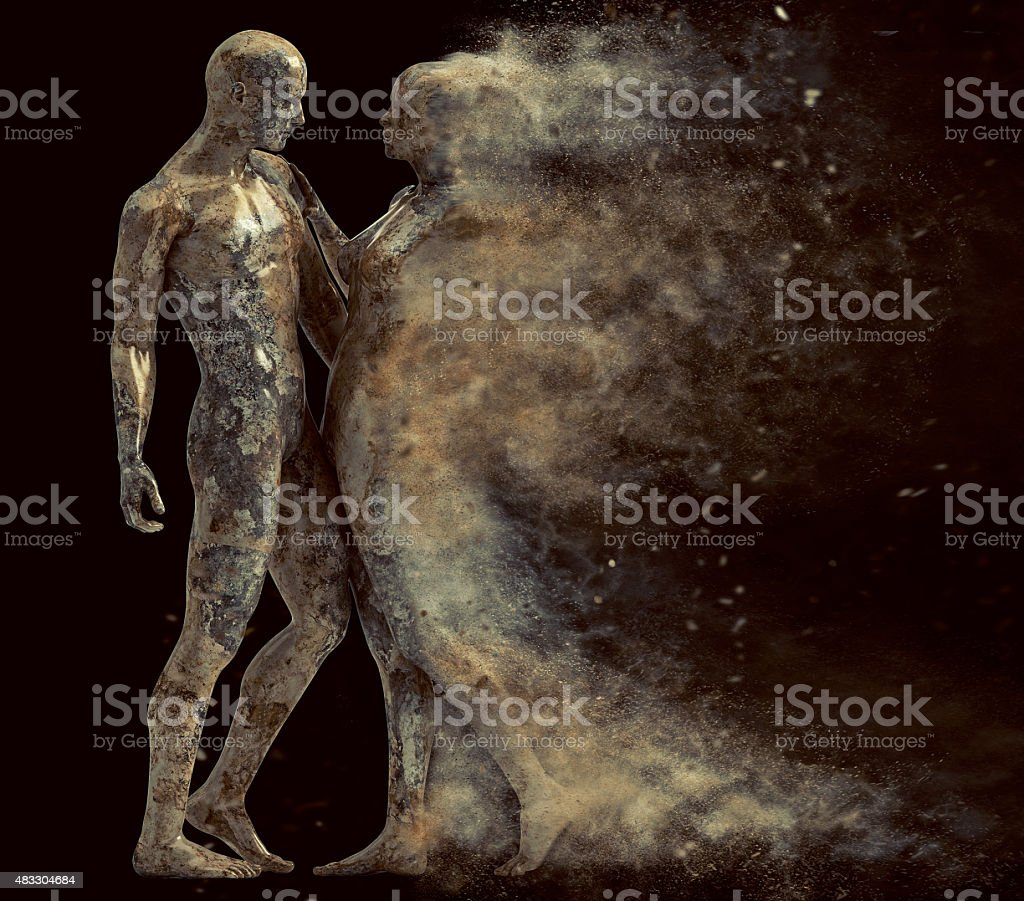 couple made of stone with the woman disintegrating stock photo