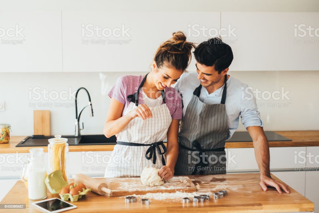 Couple making cookies stock photo