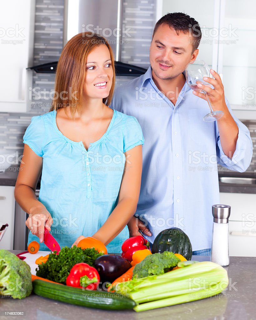 Couple making dinner together royalty-free stock photo
