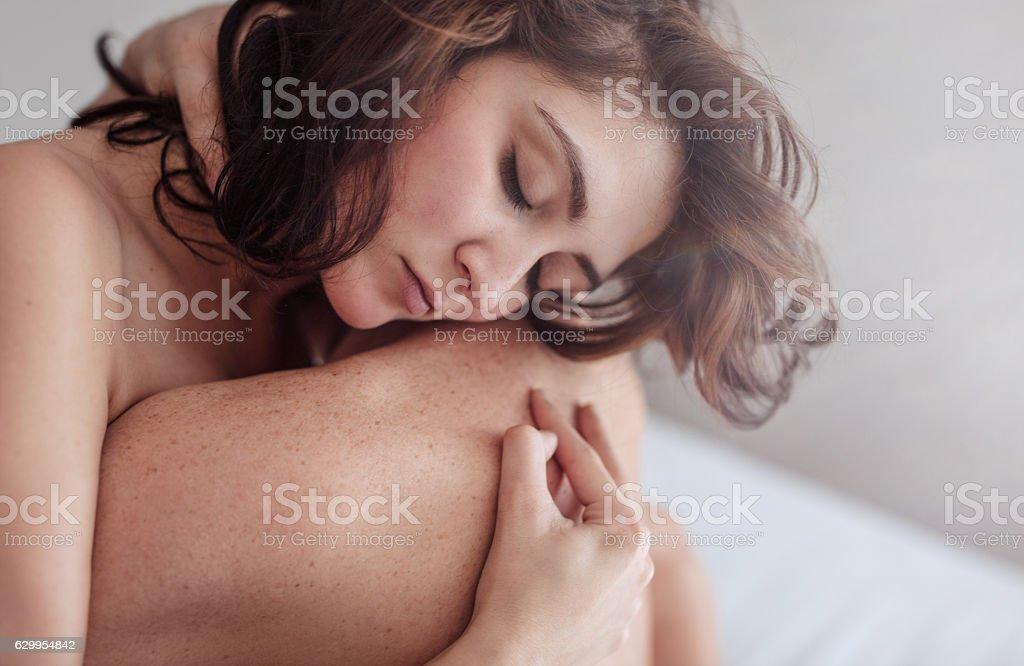 Couple making love in bedroom stock photo