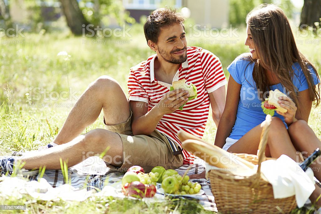 Couple making pequinique dates in the country royalty-free stock photo