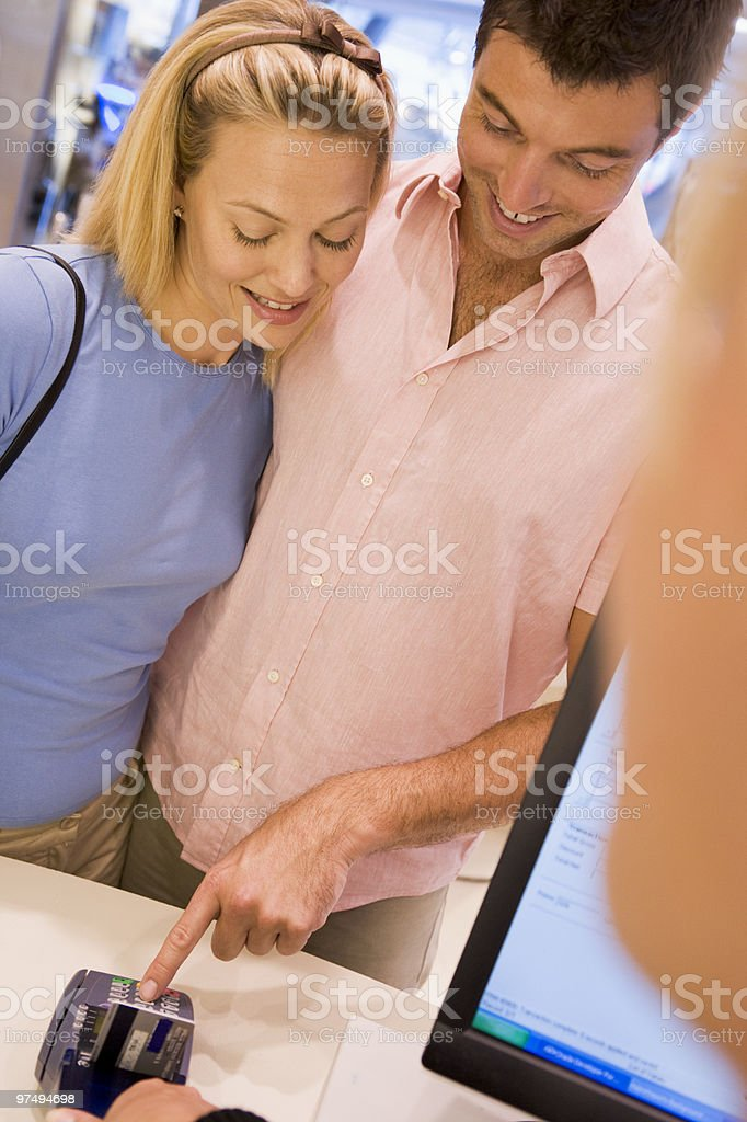Couple making purchase in store royalty-free stock photo