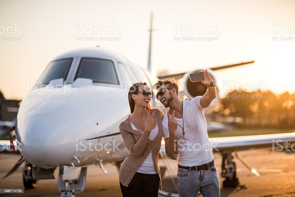 Couple making selfie at the airport stock photo
