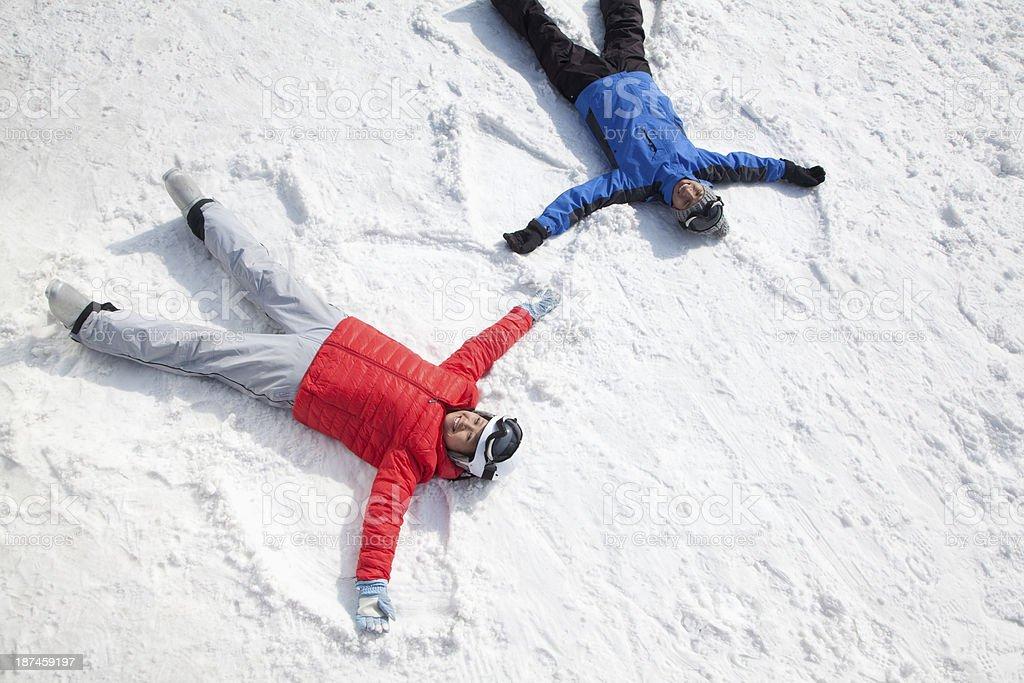 Couple Making Snow Angel stock photo