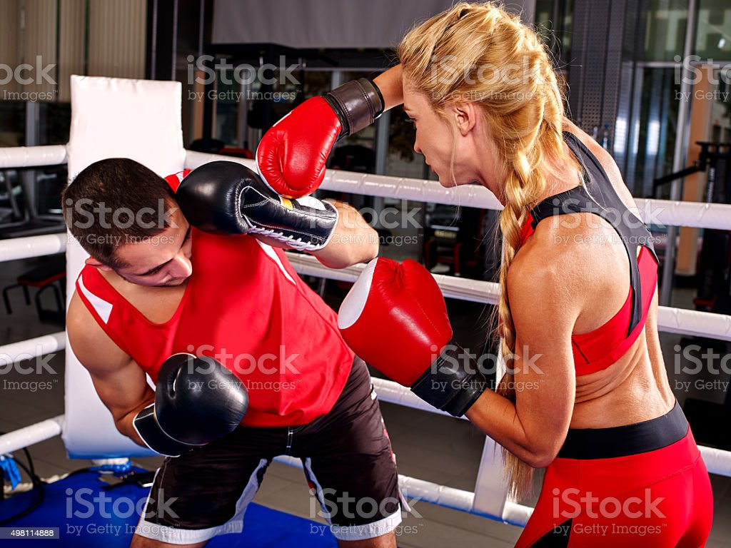 Couple Man and  Woman  Boxing in Ring stock photo