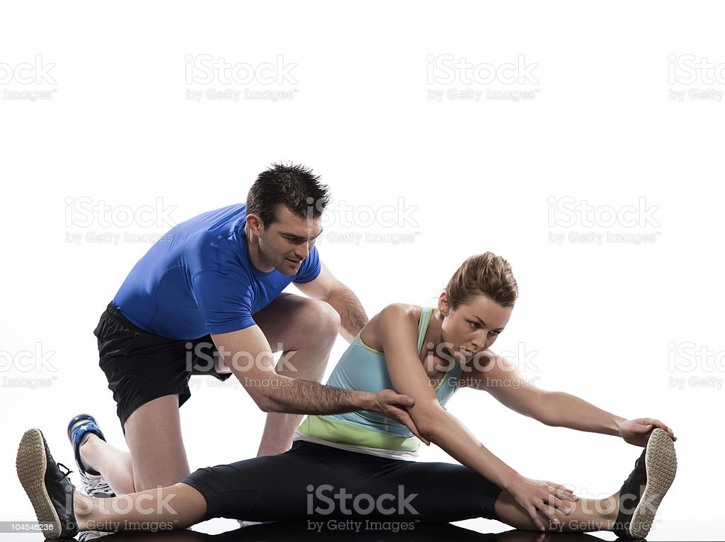 couple man and woman doing workout stretching posture stock photo
