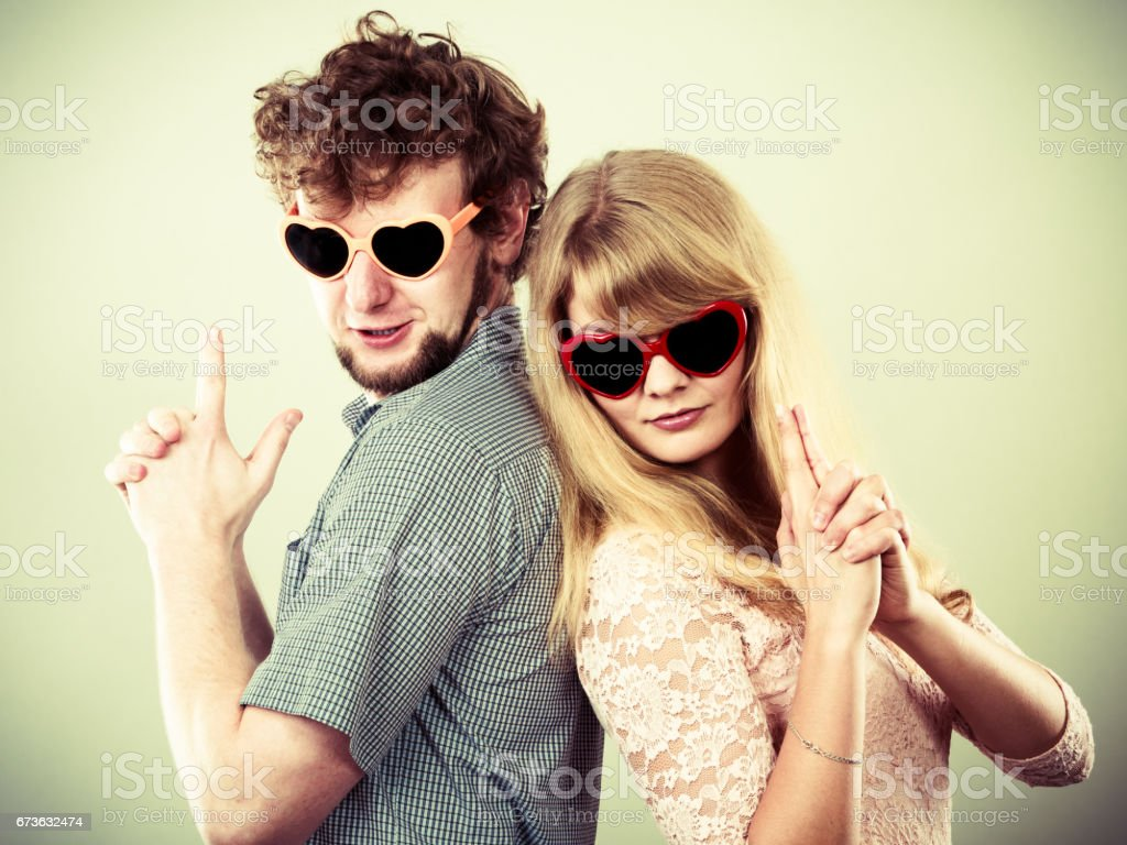 Couple man and woman making gun gesture. stock photo