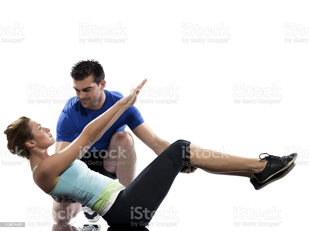 couple man and woman paripurna navasana boat pose yoga stock photo