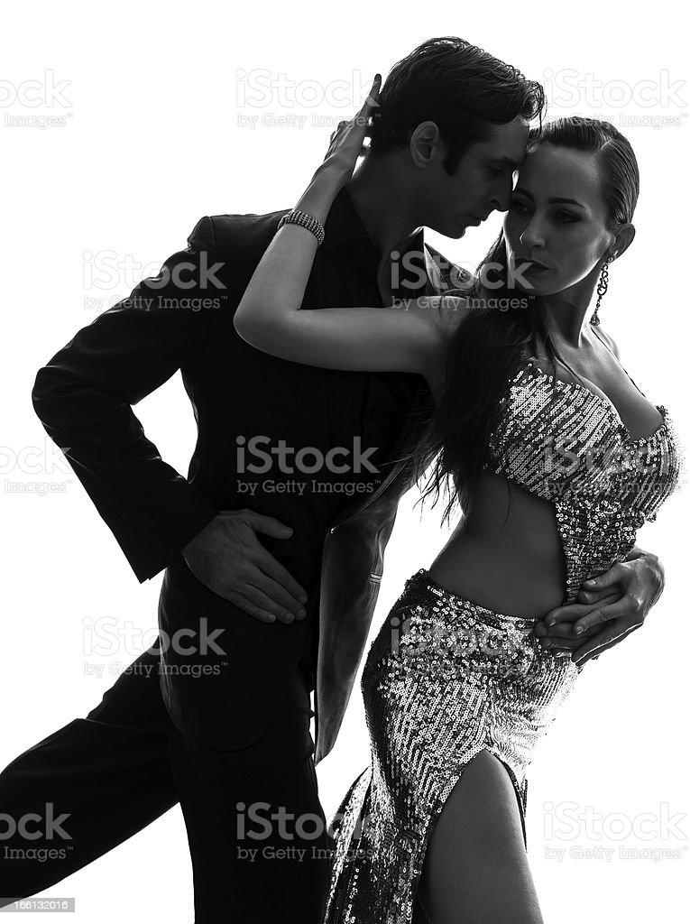 couple man woman ballroom dancers tangoing  silhouette stock photo