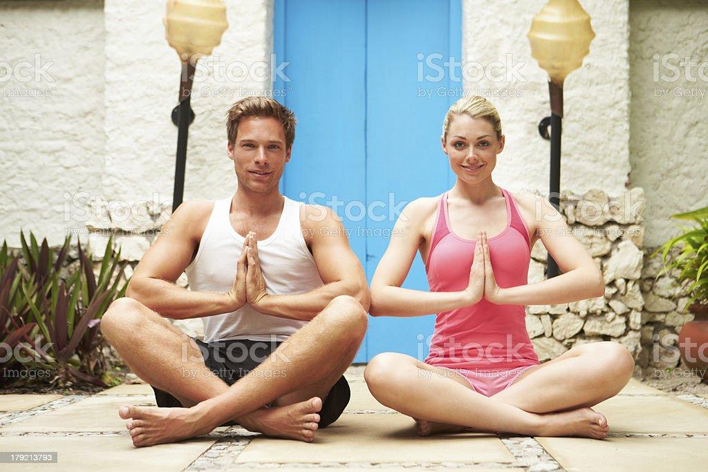 Couple Meditating Outdoors At Health Spa royalty-free stock photo