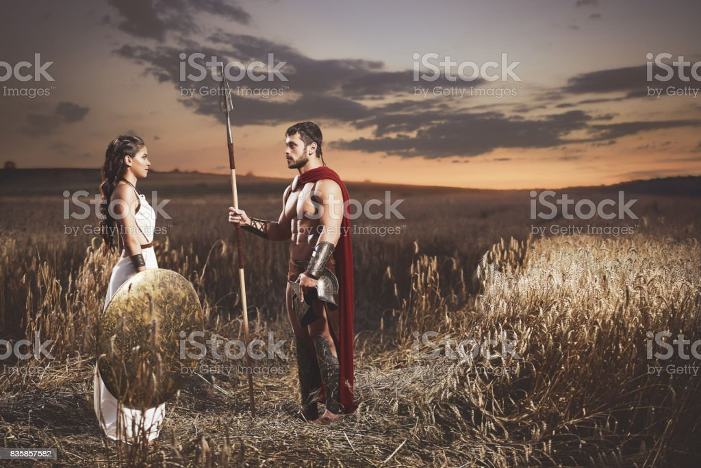 Couple meeting after war in field at night time. stock photo