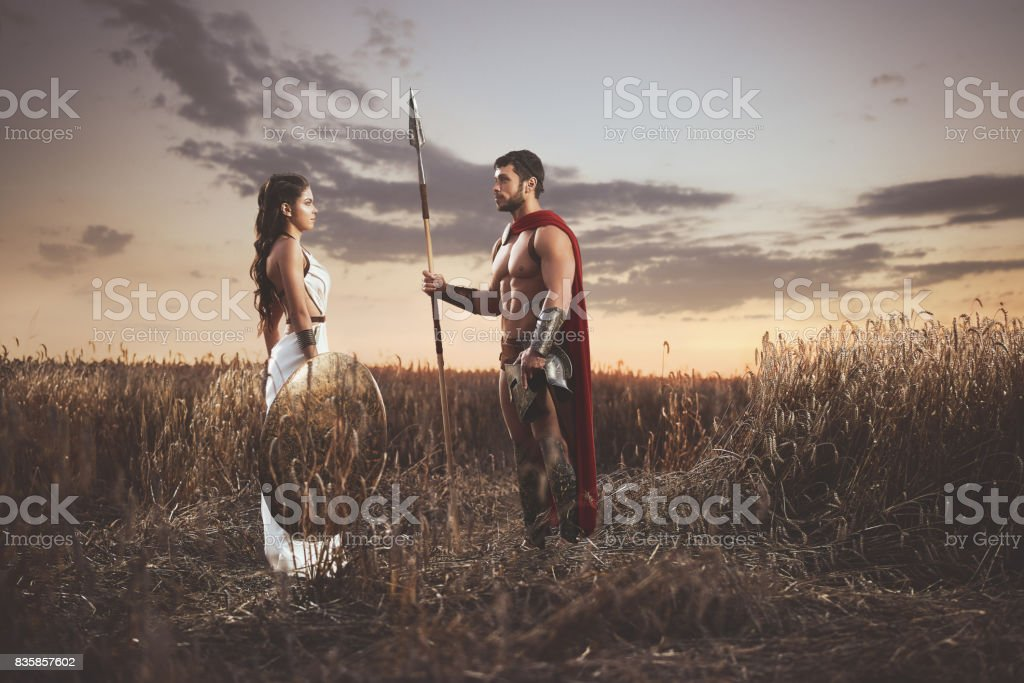 Couple meeting after war in field, looking each other. stock photo