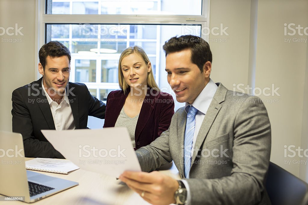 Couple meeting real-estate agent to buy property royalty-free stock photo