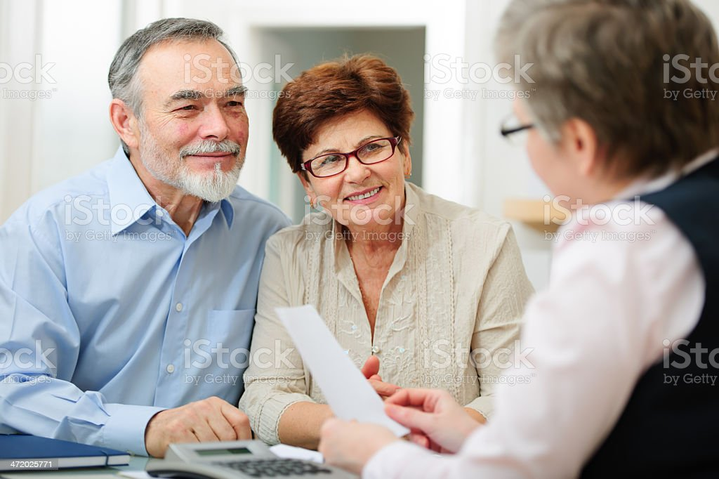 A couple meeting with a lady discussing things stock photo