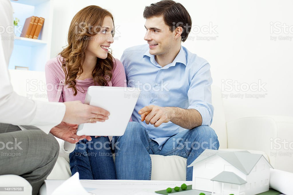 Couple Meeting With Architect. royalty-free stock photo