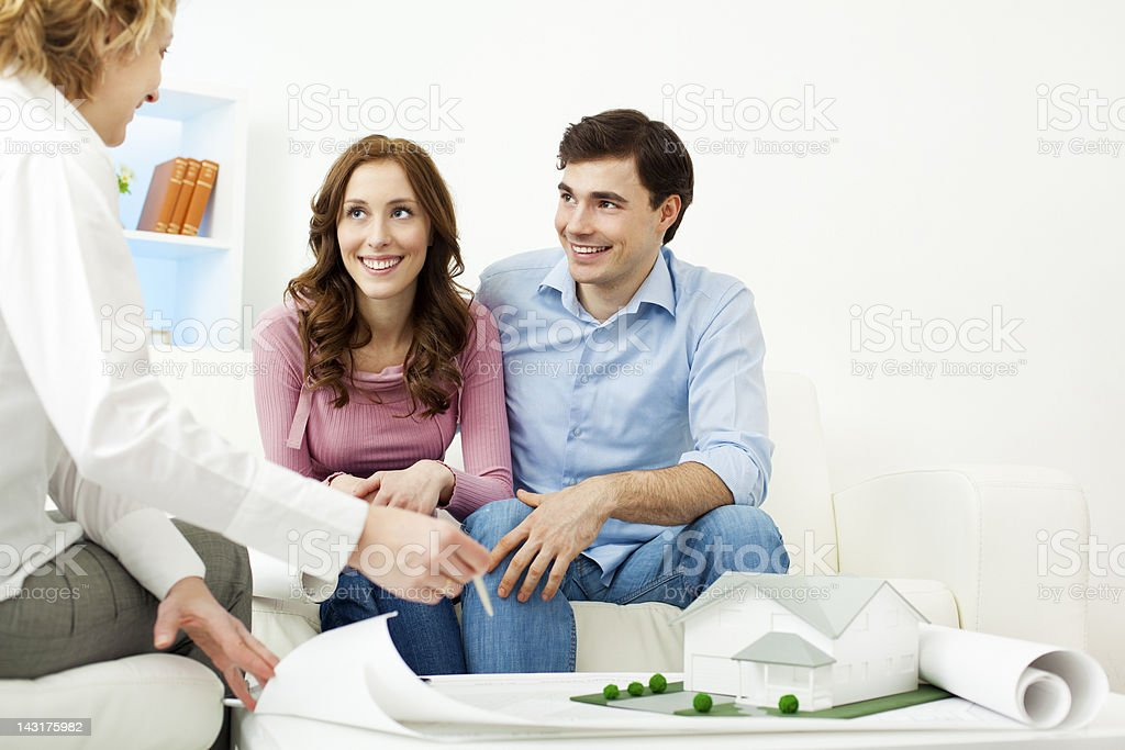 Couple Meeting With Architect royalty-free stock photo