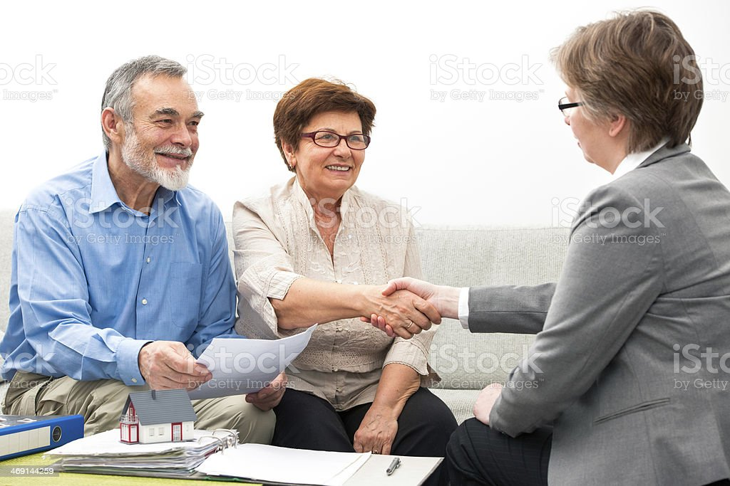 Couple meeting with financial adviser stock photo