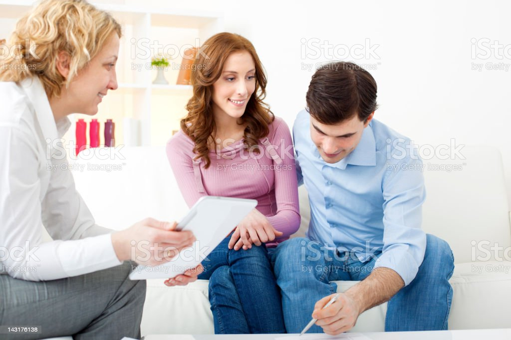 Couple Meeting With Financial Advisor. royalty-free stock photo