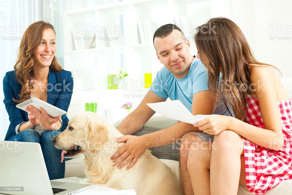 Couple Meeting With Financial Advisor. stock photo