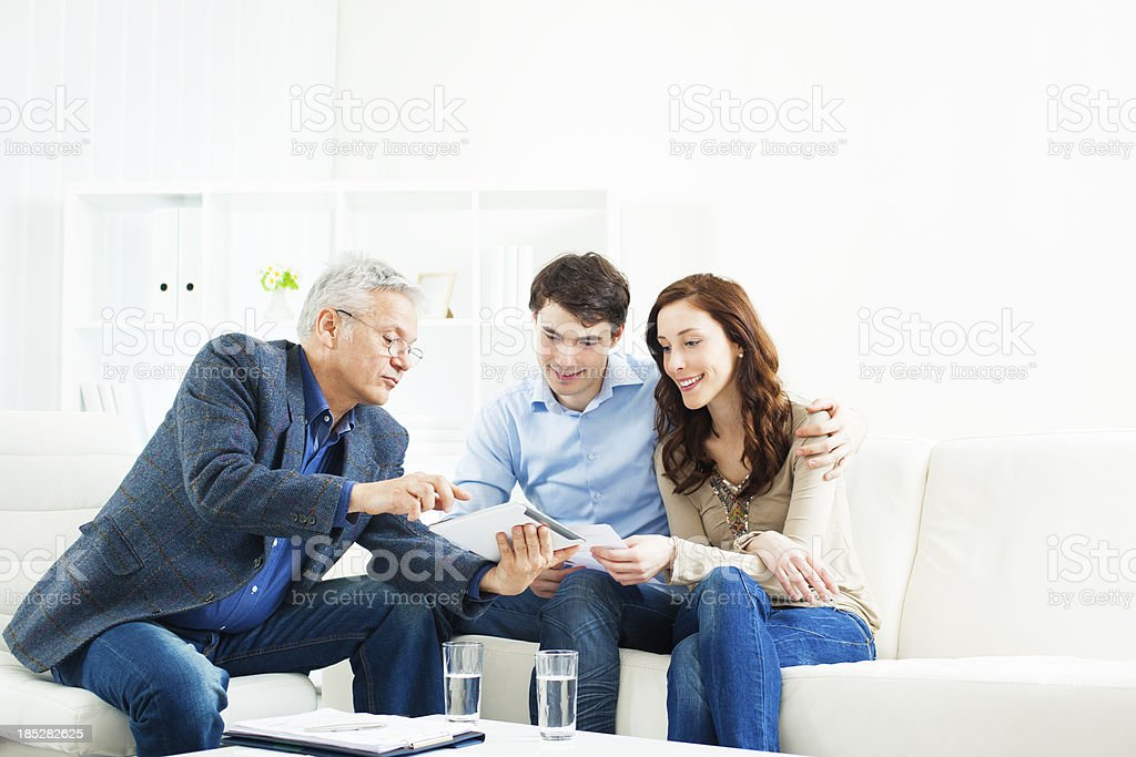 Couple Meeting With Financial Advisor royalty-free stock photo