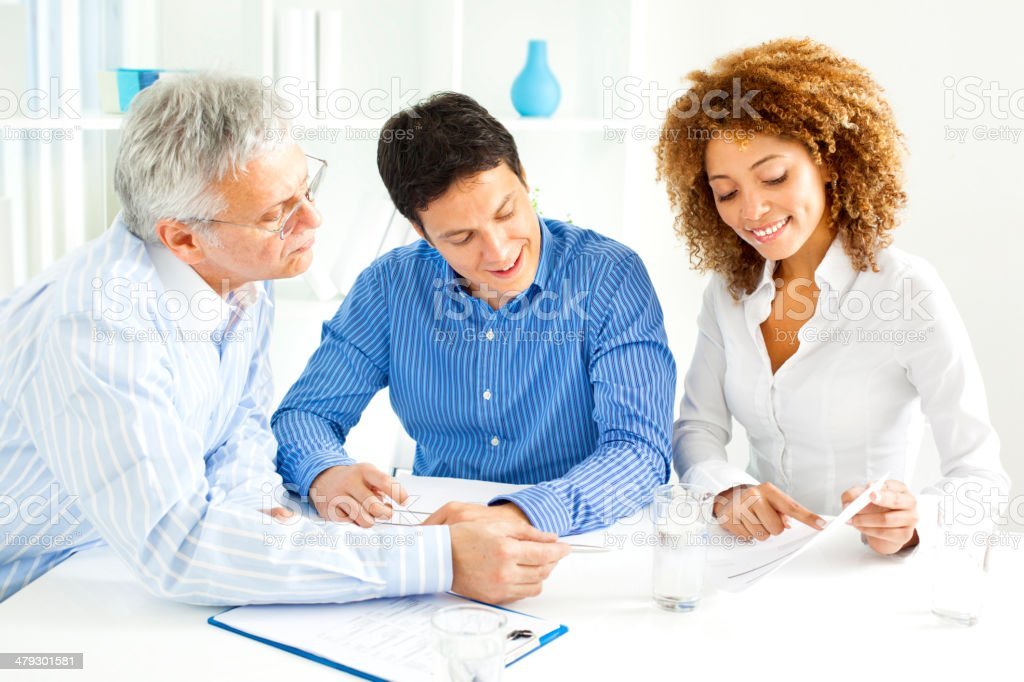 Couple Meeting With Financial Advisor stock photo